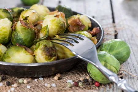 22613462 - fried brussel sprouts with ham and onions