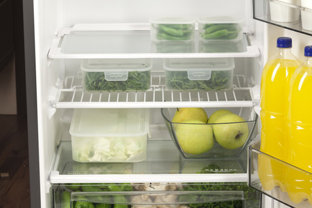 32805199 - fruits and vegetables in two containers in a modern fridge - a healthy food concept.