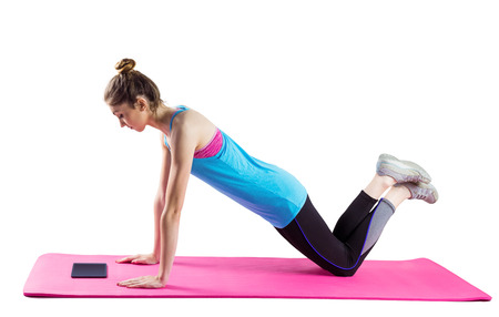 40332310 - fit woman doing press up on mat on white background
