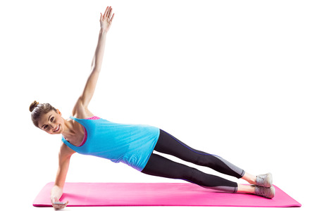 40332398 - fit woman doing side plank on white background
