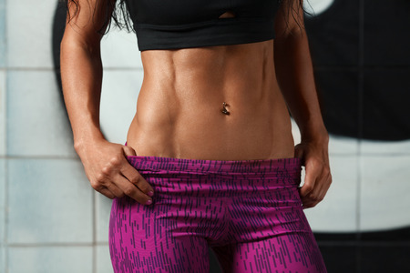 47596181 - fitness sexy woman showing abs and flat belly. beautiful muscular girl, shaped abdominal, slim waist