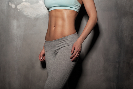 48482954 - fitness female woman with muscular body, do her workout, abs, abdominals