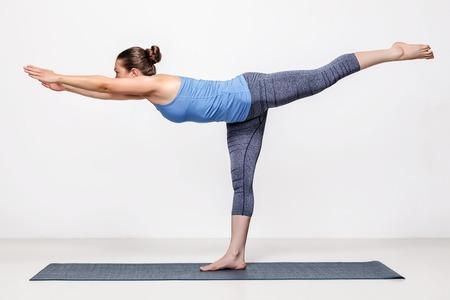 49248761 - beautiful sporty fit woman practices yoga asana virabhadrasana 3 - warrior 3 pose