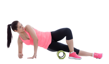 56194081 - foam roller exercise explanation and execution with a trainer.